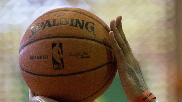Chicago Bulls' Derrick Rose shoots during a practice session ahead of a NBA Global Games match against Washington Wizards in Rio de Janeiro, Brazil, Wednesday, Oct. 9, 2013. The Chicago Bulls will face Washington Wizards on Oct. 12 in the first-ever NBA game in Brazil