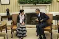 US President Barack Obama meets with Myanmar's Aung San Suu Kyi in the Oval Office. Both Nobel laureates, Obama and Suu Kyi, who wore a black blouse, black and white lunghi wrap skirt and a pink scarf, sat side-by-side, smiling, as photographers were ushered into the room before their private meeting