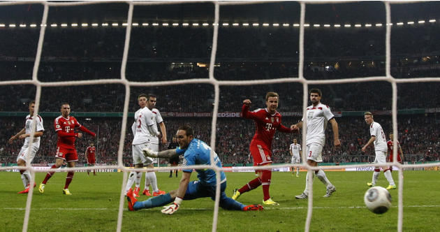 Bayern Munich's Goetze scores a goal past 1.FC Kaiserslautern's goalkeeper Sippel during their German soccer cup semi-final match in Munich