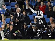 Newcastle United manager Alan Pardew (L) and Papiss Cisse during the match against Chelsea on May 2. hailed Cisse after taking his tally since his January move from German club Freiburg to 13 goals in 12 games