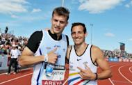 "French Christophe Lemaitre (L) poses with pole vaulter Renaud Lavilenie, after he won the 200m final during France's Athletics championships at ""Lac de Maine"" Stadium in Angers, western France. Lemaitre, seen as Europe's biggest hope to break Jamaican and US sprinting hegemony, wrapped up a French sprint triple here on Sunday"