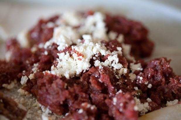 Kitfo, or Ethiopian steak tartare, is a typical Ethiopian dish that is made up of beef, butter, and mitmita (a spicy pepper powder made up of chile peppers, cardamom, cloves, and sea salt). Kitfo is p