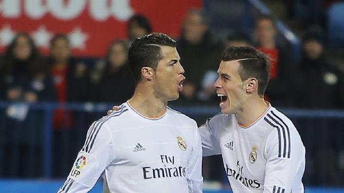 Real's Cristiano Ronaldo, left, cerebrates his goal with Real's Gareth Bale, right, during a semi final, 2nd leg, Copa del Rey soccer match between Atletico de Madrid and Real Madrid at the Vicente Calderon stadium in Madrid, Spain, Tuesday, Feb. 11, 2014