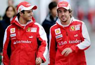 Ferrari drivers Felipe Massa of Brazil (L) and Fernando Alonso of Spain, pictured in 2010. Alonso and Massa have limited expectations from this weekend's Chinese Grand Prix in Shanghai