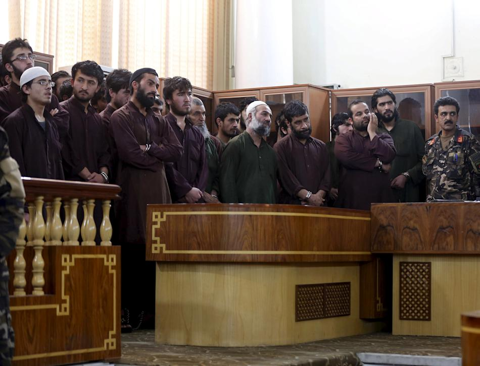 Defendants attend their trial at the Primary Court in Kabul