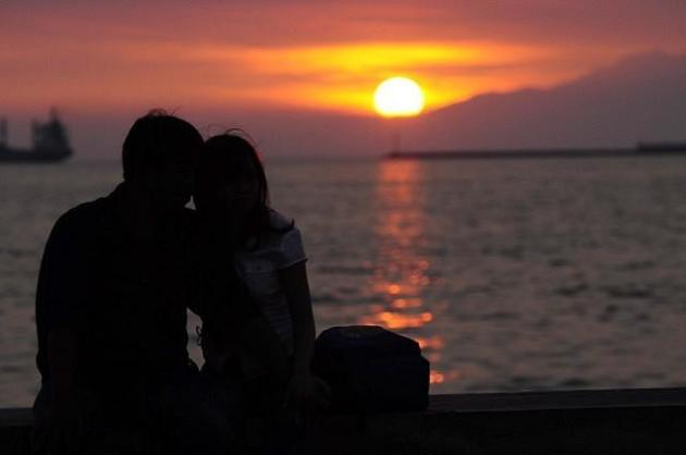 A couple spends quality time with each other sitting at the Bay Walk area in Roxas Boulevard, Metro Manila on 17 October 2012. Based on the survey conducted by the Veritas Truth Survey (VTS), a growing number of Filipino Catholic couples are living together civilly but are not married in the church. Novaliches Bishop Emeritus Teodoro Bacani Jr. who is the Vice Chairman of CBCP Episcopal Commission on the Doctrine of Faith called this as an eye opener considering that the Christian family is the foundation of the Church as the family is the foundation of the society. (Angela Galia/NPPA images)
