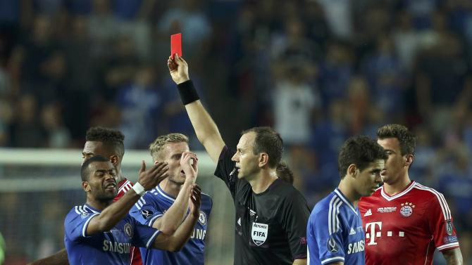 Chelsea's Ramires is sent off the pitch by referee Jonas Eriksson from Sweden during their UEFA Super Cup soccer match against Bayern Munich at Eden stadium in Prague