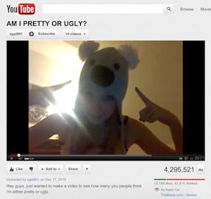 """This image made on Friday, March 2, 2012 from video posted on the YouTube website on Dec. 17, 2010 shows a girl with a koala hat asking """"Am I pretty or ugly?"""" The video has more than 4 million views and more than 107,000 anonymous, often hateful responses in a troubling phenomenon that has girls as young as 10 - and some boys - asking the same question on YouTube with similar results. (AP Photo)"""