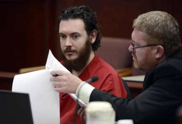 Defense Attorney Daniel King, right, and  Aurora theater shooting suspect James Holmes review advisement documents in court in Centennial, Colo., on Tuesday, June 4, 2013. Holmes was allowed to change