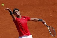 Spain's Rafael Nadal serves to Italy's Simone Bolelli at the Roland Garros stadium in Paris. Nadal overcame a second-set blip as he thrashed Bolelli 6-2, 6-2, 6-1