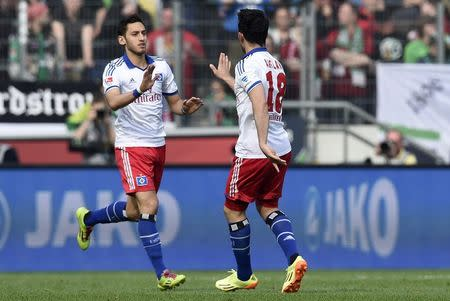 Hamburg SV's Calhanoglu is congratulated by his team mate Arslan after scoring during their German Bundesliga first division soccer match against Hanover 96 in Hanover