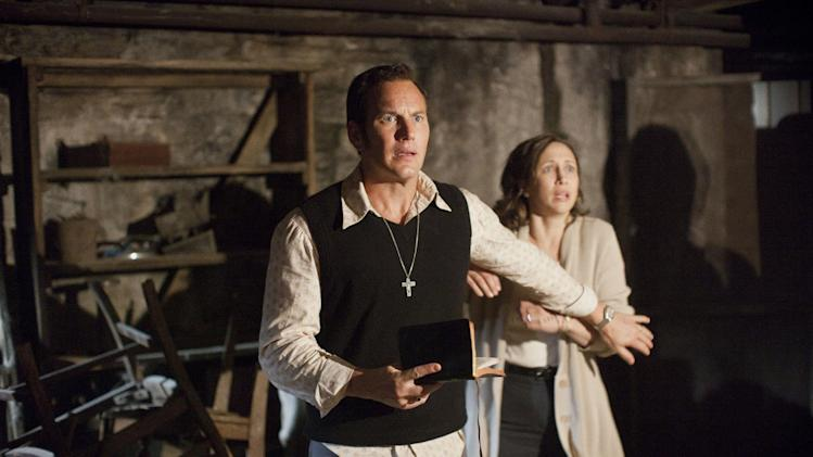 "In this publicity image released by Warner Bros. Pictures, Patrick Wilson portrays Ed Warren, left, and Vera Farmiga portrays Lorraine Warren in a scene from ""The Conjuring."" (AP Photo/New Line Cinema/Warner Bros. Pictures, Michael Tackett)"
