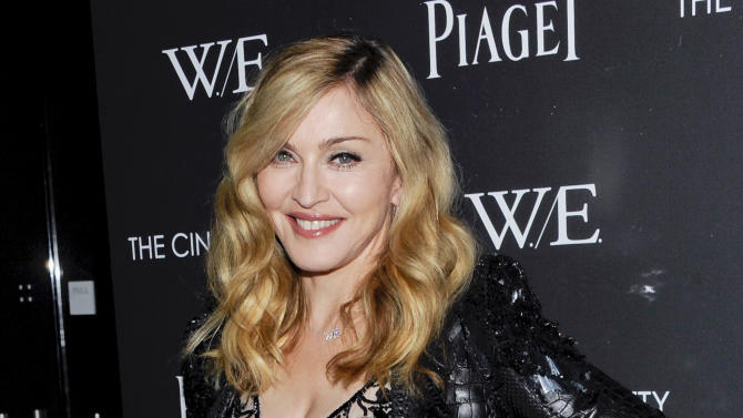 """Director Madonna attends a special screening of """"W.E."""" at the Museum of Modern Art on Sunday, Dec. 4, 2011 in New York. (AP Photo/Evan Agostini)"""