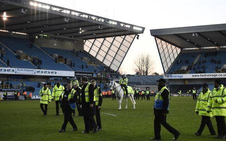 Police and Stewards on the pitch after the match