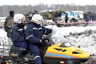 A photo provided on April 2, 2012 by the Russian Emergencies Ministry's Tyumen Regional Department shows rescuers and investigators at site in Siberia where a plane crash on Monday killed 31 people. The French-Italian made ATR-72 passenger plane run by private Russian airline UTair came down moments after takeoff some 45 km (28 miles) from the western Siberian city of Tyumen