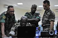 ECOWAS army officers hold a meeting of chiefs of staff on January 16, 2013 at the Mali peacekeeping traning center in Bamako. After days of airstrikes on Islamist positions in the northern territory the rebels seized in April, French and Malian troops battled the insurgents in the small town of Diabaly