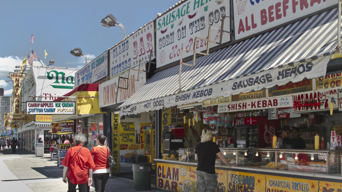 This June 12, 2013 photo shows various food stands along Surf Avenue in the Coney Island section of the Brooklyn borough of New York. (AP Photo/Bebeto Matthews)