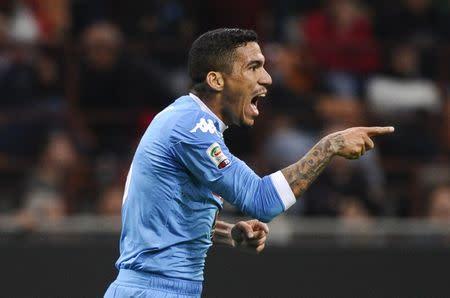 Napoli's Allan celebrates after scoring against AC Milan during their Italian Serie A soccer match at the San Siro stadium in Milan