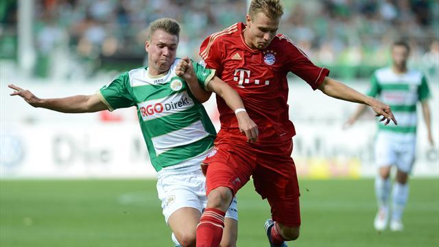 Bayern beat debutants, Wolfsburg win at death