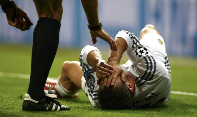 Real Madrid's Carvajal reacts after a foul during the Champions League semi-final first leg soccer match against Bayern Munich at Santiago Bernabeu stadium in Madrid