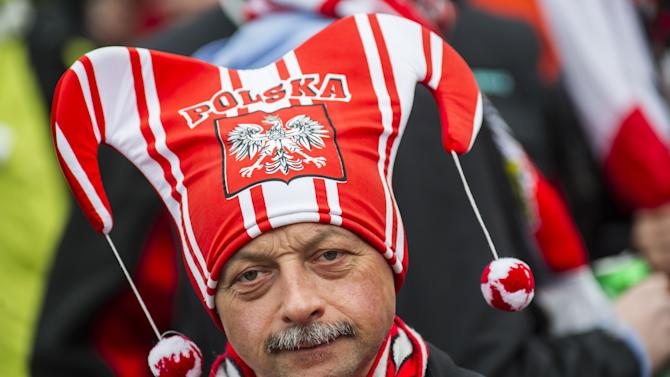 A Polish fan poses during the final round of FIS Ski Flying World Cup 2011-2012 in Planica on March 18, 2012. AFP PHOTO / Jure Makovec (Photo credit should read Jure Makovec/AFP/Getty Images)