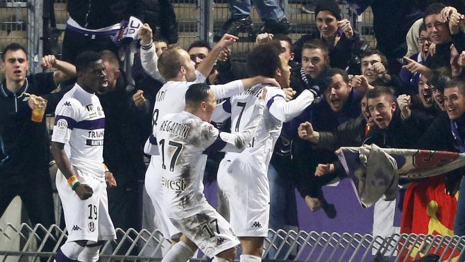 Toulouse's Martin Christensen Braithwaite celebrates with his teammates and supporters after scoring against Girondins Bordeaux during their French Ligue 1 soccer match at the Chaban Delmas Stadium in Bordeaux