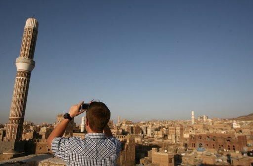 A tourist takes a picture of Sanaa's Old City on January 15, 2010 where three foreigners were kidnapped this weekend. Yemeni authorities say they are looking for the hostages