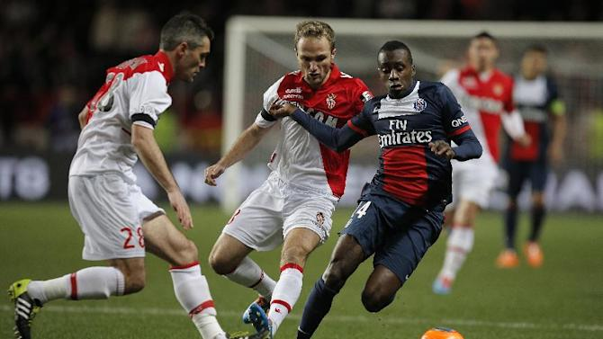 Paris Saint Germain's Yohan Cabaye of France, right, challenges for the ball with Monaco's Joao Moutinho of Portugal, center and Monaco's Jeremy Toulalan during their French League One soccer match, in Monaco stadium, Sunday, Feb. 9 , 2014