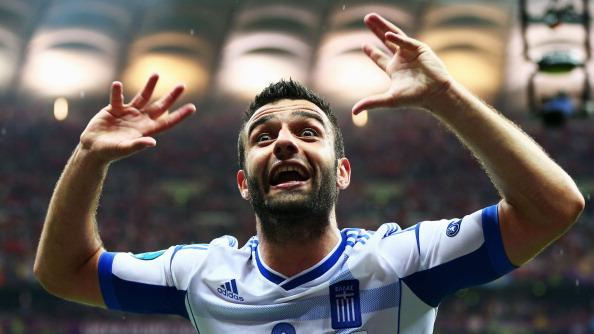 Giorgos Tzavelas of Greece celebrates victory and progress to the quarter finals during the UEFA EURO 2012 group A match between Greece and Russia at The National Stadium on June 16, 2012 in Warsaw, Poland. (Photo by Shaun Botterill/Getty Images)