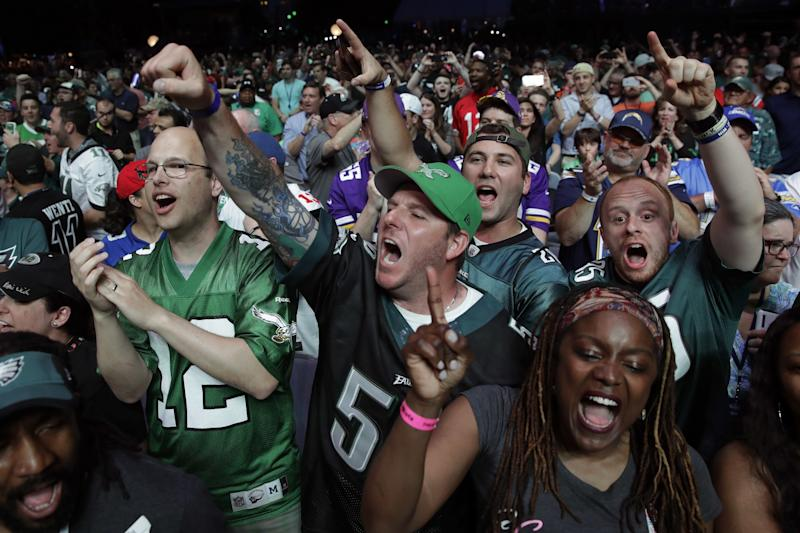 Fans love the NFL draft. Here's an idea how to take the next step — let them help make picks. Seriously. (AP)