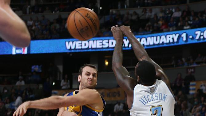 Golden State Warriors center Andrew Bogut, left, of Australia, fires a pass as Denver Nuggets forward J.J. Hickson covers in the first quarter of an NBA basketball game in Denver, Monday, Dec. 23, 2013