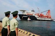 "Chinese paramilitary guards watch as a China National Offshore Oil Corp. (CNOOC) deep-water oil drilling rig leaves the port of Qingdao, east China's Shandong province in May 2012. Vietnam has denounced China's opening of offshore oil blocks to foreign companies in contested areas of the South China Sea as ""illegal"", as territorial tensions grow between the communist neighbours"