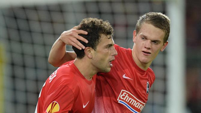 Admir Mehmedi , left,  of Freiburg celebrates with Matthias Ginter after scoring  agoal  during the UEFA Europa League Group H   soccer match between SC Freiburg and Slovan Liberec FC at Mage Solar Stadium Stadium in Freiburg, Germany,  Thursday Sept. 19,  2013