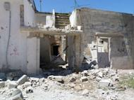 A handout picture released by Shaam News Network shows the alleged destruction by Syrian government forces in the city of Qusayr