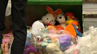 In memory of the three children, stuffed animals were piled onto tractors in front of the church where their funeral was held.