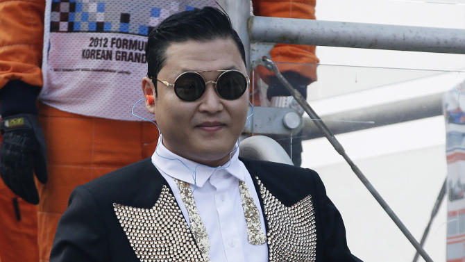 FILE - In this Oct. 14, 2012 file photo, South Korean rapper PSY leaves the finish tower after he waved the checkered flag at the conclusion of the Korean Formula One Grand Prix at the Korean International Circuit in Yeongam, South Korea. U.N. Secretary-General Ban Ki-moon  joked during a Tuesday, Oct. 23, 2012 meeting with the rapper that he felt overshadowed by the star, whose video has scored over half a billion views on YouTube. (AP Photo/Mark Baker, File)