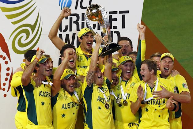 Australia's captain Clarke holds aloft the Cricket World Cup trophy as he celebrates with team mates after they defeated New Zealand in the final match at the MCG