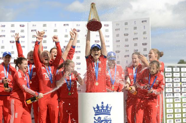 England's captain Charlotte Edwards lifts the trophy as the team celebrates winning the Ashes series after defeating Australia in Chester-le-Street