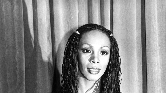 "FILE - In this Jan. 18, 1980 file photo, Donna Summer poses with her award at the American Music Awards in Los Angeles, Calif. Summer, the Queen of Disco who ruled the dance floors with anthems like ""Last Dance,"" ""Love to Love You Baby"" and ""Bad Girl,"" has died. Her family released a statement, saying Summer died Thursday, May 17, 2012. She was 63. (AP Photo/Nick Ut, File)"