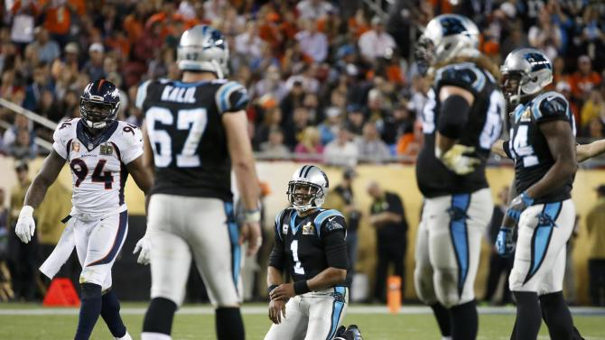 Carolina Panthers' quarterback Cam Newton kneels on the turf after throwing an interception against the Denver Broncos in the third quarter of the NFL's Super Bowl 50 in Santa Clara