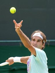 Swiss tennis player Roger Federer trains on July 25 at Wimbledon, two days before the start of the London Olympics. US NBA superstar LeBron James edges Federer for the title of biggest moneymaker at the London Olympics with an annual income of $53 million, according to Forbes magazine