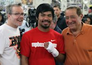 Freddie Roach, Manny Pacquiao and Bob Arum. (Getty Images)