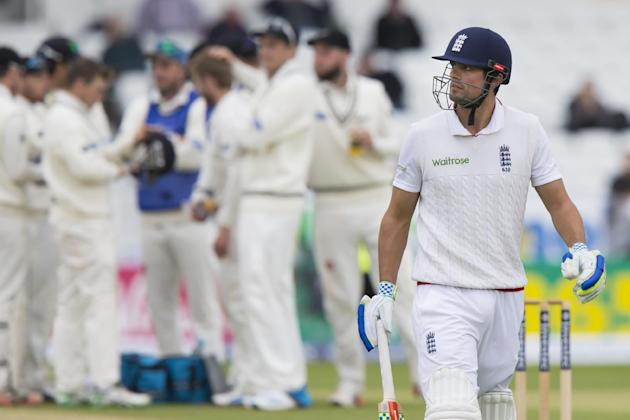England's captain Alastair Cook walks from the pitch after loosing his wicket for 56, trapped LBW by New Zealand's Kane Williamson  on the fifth day of the second Test match between England an