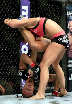 Felice Herrig and Paige VanZant grapple during their women's strawweight bout. (Getty)
