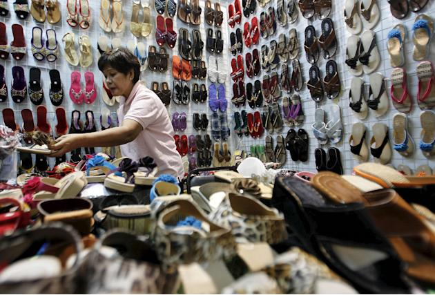 File photo of a woman selling sandals made of local materials during a fair at a mall in Manila
