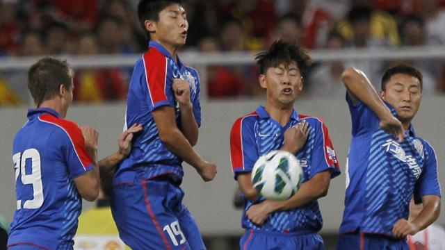 World Football - Shenhua lose league title due to match-fixing