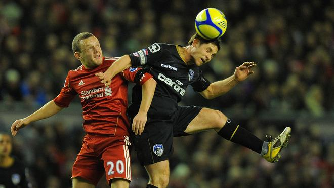 Liverpool's English Midfielder Jay Spearing (L) Vies With Oldham Athletic's Italian Forward Luca Scapuzzi    RESTRICTED AFP/Getty Images