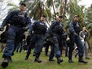 Illustration of armed police in Sydney, Australia. Some 350 police took part in dawn raids at 30 properties across Sydney and elsewhere in New South Wales state targeting the Hells Angels, Rebels and Comancheros, as well as Asian and Balkan crime organisations, police said