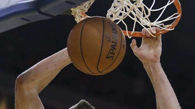 Golden State Warriors' David Lee scores against the Sacramento Kings during the second half of an NBA basketball game on Saturday, Nov. 2, 2013, in Oakland, Calif