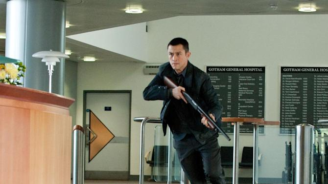 "In this publicity photo provided by Warner Bros. Pictures, Joseph Gordon-Levitt as John Blake is shown in a scene in Warner Bros. Pictures' and Legendary Pictures' action thriller ""The Dark Knight Rises.""  After the theater shooting in Colorado on July 20, 2012 at the film's midnight screening, Warner Bros. quickly pulled a trailer for its upcoming film ""Gangster Squad."" The new movie features a star-studded cast, along with a climactic scene in which mobsters fire automatic weapons into a movie theater audience from behind the screen. (AP Photo/Warner Bros. Pictures, Ron Phillips)"